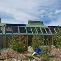 Earthship. Greater World Community