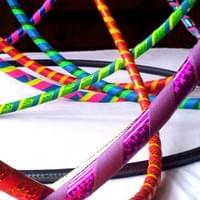 Multicoloured shiny adult and child hula hoops, handmade to order in Somerset