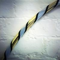 Classic black and gold soiral taped hula hoop from The Joy of Hooping