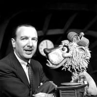 Walter Cronkite co-anchors with Charlemagne the lion puppet