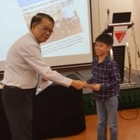 Peter Poon receiving his Bible course certificate of completion