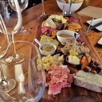 Charcuterie, bread, wine, pickles, cheese