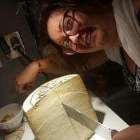 Julie is cutting a big cheese