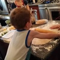 Cyrus rolling out stromboli dough!