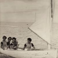 Shiplap wooden dinghy with Wet Hens aboard, circa 1964.