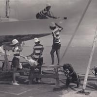 Maintaining the fleet is hard work, especially while simultaneously babysitting.  The Wet Hens in 1963.
