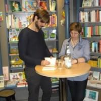 Giving inscription  at a reading in south-Germany