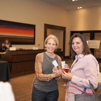 Two women exchanging business cards