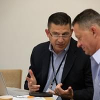 Two men conferring during a business conference