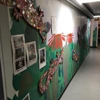 Mural and decorative wood newt panels to create interest in a connecting corridor to Nursery School