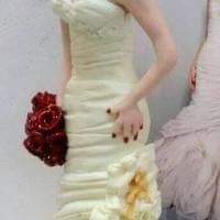 Bride figure in designer dress