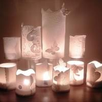 Porcelain  tea lights and candle covers .
