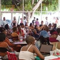 Audience members at event hosted at the Hot and Cool Cafe in Leimert Park.