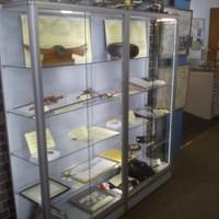Artefacts display cabinet with LED lighting at The Spitfire & Hurricane Memorial Museum, RAF Manston in Ken