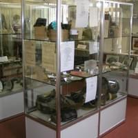 Brwnmawr Museum, South Wales. Simple and elegant display cabinet with double shelves in pairs for versatility.