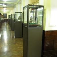 Museum of Freemasonry, London. Pedestal cabinets with a bronze powder coated framework.  Laminated glass and painted base panels.
