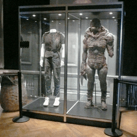 London Film Museum, Covent Garden. Double costume cabinet with LED down lights and black laminate panelling.