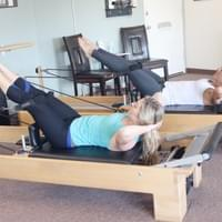 Abdominals With Legs in Straps on the Reformers