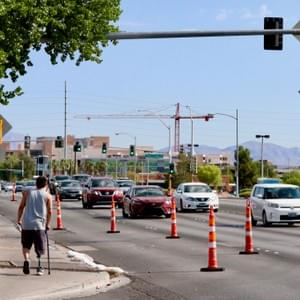 Man walks down Maryland Parkway as cars pass by. Las Vegas, NV, July 26, 2018. Photo by Guadalupe Pantaleon.