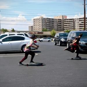 Two boys skateboard into oncoming parking traffic, August 2018, Las Vegas, NV.  Photo by Alexia Zilliken