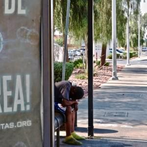 A man seeks refuge from the harsh Las Vegas sun under a shaded bus stop along Maryland Parkway just outside of Sunrise Hospital. Las Vegas, NV July 30, 2018 Photo by Shelby Goldberg