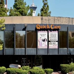 A view of the round Quick Care building located across from Sunrise Hospital. The Stratosphere looms in the background, overlooking Maryland Parkway. Las Vegas, NV July 30, 2018 Photo by Shelby Goldberg.