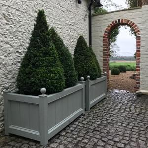 Planting troughs with finials, lined and insulated for conventional planting