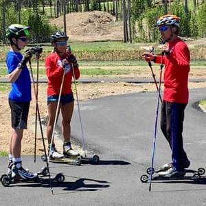 Andy Leibner, international racer and author, helped Nome Nordic senior Mallory Conger with roller ski technique. Mallory, in turn, brought these lessons back to her Nome Nordic teammates.