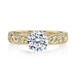 A Unique Hand-Engraved Solitaire Engagement Ring with Embellished Side Profile. Shown in Yellow Gold with One and One Quarter Carat Brilliant Cut