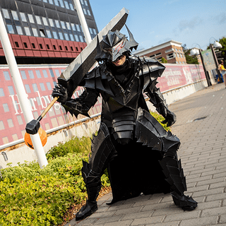 Cosplayer posing as Guts from Berserk.