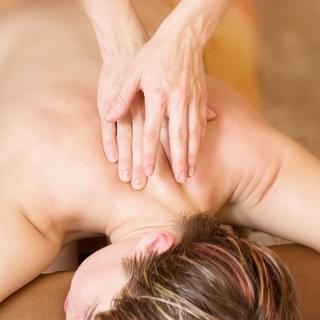 Woman Receiving Neck & Upper Back Massage