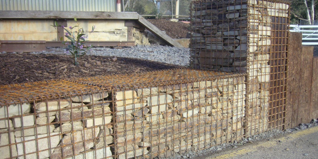 Gabion basket with flat rock for retaining wall