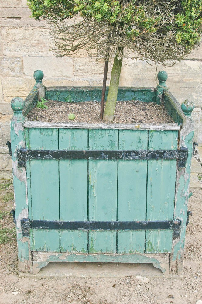 Bramham Park old wooden planters showing classic deterioration of wood and steel straps