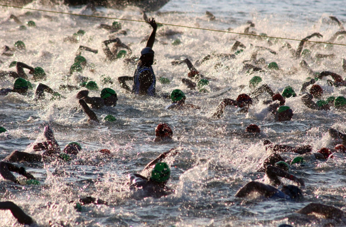 Image of triathlon swimmers representing accountability