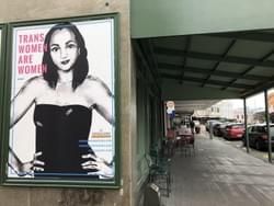 Spreading the love for trans whānau throughout the streets of New Zealand, with a poster that reads: Trans Women are Women