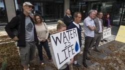 A group of volunteers working to save our water from corporate greed