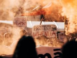 "Signs at the Ihmaatao solidarity action that say ""protect Ihumaatao"" and ""protect the whenua"