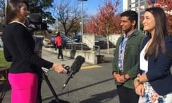 Kera O'Regan (right) and Jibi Kunnethedam talking to media on behalf of the NZ Medical Students Association and Auckland University Medical Students Association to lift limits on student loans.