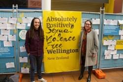 Laura and Councillor Fleur Fitzsimons with a banner that reads: Absolutely Positively Sexual Violence Free Wellington