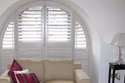 Wooden Shutters Arched Window