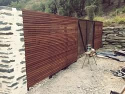 Cedar, Steel and Stone Fence Construction.