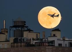 Airplane Crosses the 'Supermoon' Over NYC