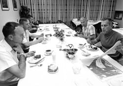 "The Apollo 11 crew and Donald K. ""Deke"" Slayton look over charts during the traditional launch day breakfast of steak and eggs on July 16, 1969. (NASA)"