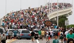 Spectators line the A. Max Brewer bridge in anticipation of the launch of the space shuttle Atlantis in Titusville, Fla. July 8, 2011. (Hans Deryk/Reuters)