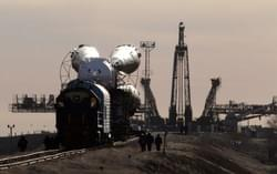 The Soyuz TMA-18 spaceship is transported by train to the launch pad at Baikonur cosmodrome in Kazakhstan, March 31, 2010. (REUTERS/Sergei Karpukhin)