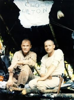 Neil Armstrong & John Glenn in good spirits, sitting at their makeshift ''Choco Hilton'' camp during jungle survival training in Panama, June 3-6 1963