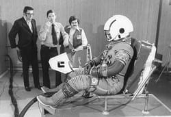 Photograph of Jack Schimitt taken on March 8,1972 which participates in a test of the A7-LB suit not coated with its outer TMG layer. In the background are, on the left, NASA representative John Leshko at the John McMullen Center and Steve Rubin, engineer of the A7-LB suit, on the right.