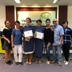 Receiving our certificates after 40 hours of intensive Vietnamese language study.