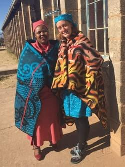 My counterpart, Mme Malerato, and I before a cultural event at the local high school. I did not own a kobo (blanket) yet so she let me borrow hers!