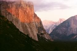 El Capitan and Yosemite Valley with setting sun by Alden Olmsted